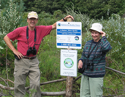 The Caveny's with Landowner Leader official signage on their property