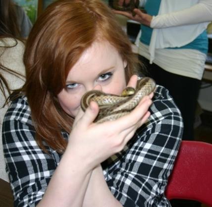 WCI students holds a native snake